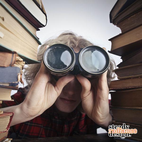 Man looking through binoculars for search engine ranking